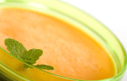 Chilled Melon Soup. Bowl of Chilled Melon Soup made from Canteloupe, yogurt and orange juice royalty free stock photos
