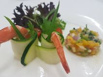 Chilled Prawn Cocktail with Mango Salsa and Mesclun Mix on white plate. Chill Prawn Cocktail with Mango Salsa Stock Image