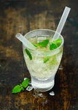 Chilled vodka or gin cocktail Hugo on ice. High angle view of a refreshing chilled vodka or gin cocktail Hugo on ice with fresh mint leaves and two straws on an royalty free stock images
