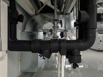 Chilled water pipe installation with balancing valve and cover with high density of insulation. On ahu room royalty free stock photo