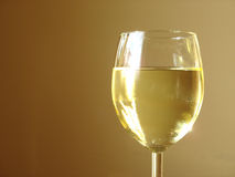 Chilled White Wine. In a glass with a peach background Stock Images