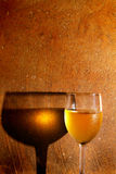 Chilled white wine. Chilled glass of white wine against textured background royalty free stock photo