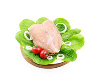Chilled whole chicken breast. On wooden plate and on the plate Stock Images