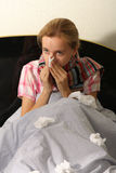 Chilled woman in bed Royalty Free Stock Images