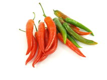 Chilli. Red and green chili on white studio isolated background stock images