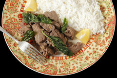 Chilli beef with basil over black Stock Photography