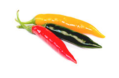 Chilli (Capsicum frutescens L.). Three colors on a white background Stock Photo