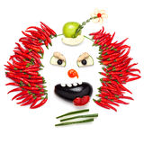 Chilli clown. A creative food concept demonstrating a creepy halloween clown with the help of chilli pepper and other vegetables stock image