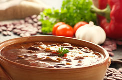 Chilli con carne. With ingredients and spoon stock photography