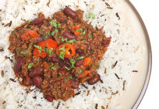 Chilli con Carne with Rice. Chilli con carne with plain long-grain and wild rice Royalty Free Stock Photo