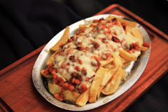 Chilli covered fries Royalty Free Stock Photo