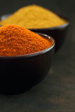 Chilli and curry powder Stock Images