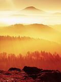 Chilli day in rocks. Rocky peak of mountain in winter day. Stock Image