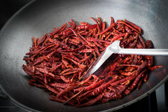 Chilli dry in the pan Stock Images