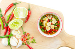 Chilli and garlic in fish souce isolated Royalty Free Stock Photo