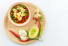 Chilli and garlic in fish souce isolated Royalty Free Stock Photography
