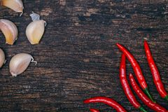 Chilli and garlic on wood background royalty free stock photos