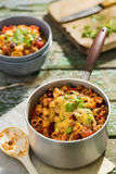 Chilli mac and cheese. With parsley stock photo