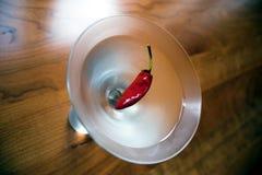 Chilli martini. Ice cold martini with a chilli garnish stock photo