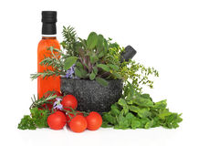 Chilli Oil, Herb Leaves and Tomatoes Royalty Free Stock Images