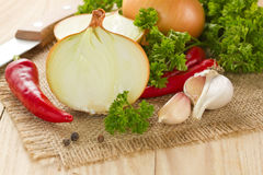 Chilli, onion and garlic. On the wooden table Stock Photo