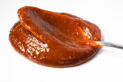 Chilli paste. A spicy korean chilli paste with spoon Stock Image