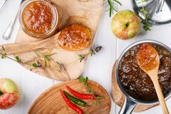 Chilli pepper apple jam with herbs stock image