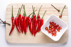 Chilli pepper on chopping block Stock Photography