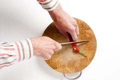 Chilli pepper and Knife on chopping board Stock Photos
