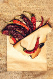 Chilli pepper in paper on burlap Stock Images