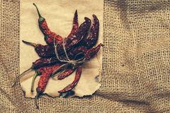 Chilli pepper in paper on burlap Stock Photos