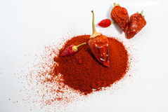 Chilli pepper with pile of milled peppers.  Royalty Free Stock Images