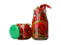 Realistic canned chilli pepper, izolated on white background. Opened glass jar of mexican food. Stock Image