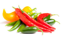 Chilli peppers. Coloured chilli peppers isolated on white royalty free stock photography