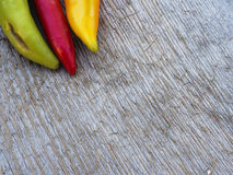 Chilli peppers. Autumn background Royalty Free Stock Image