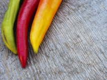 Chilli peppers. Autumn background Stock Photos
