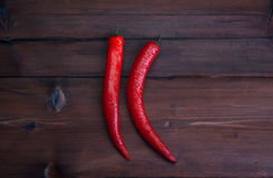 Chilli peppers on dark wood background. Hot peppers on dark wood background Stock Images