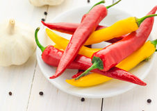 Chilli peppers garlic wooden table Stock Image