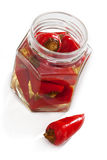 Chilli peppers in marinate. Chilli peppers marinated and preserved in jar Stock Photos