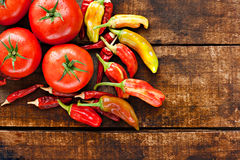 Chilli peppers and tomatoes Royalty Free Stock Photo