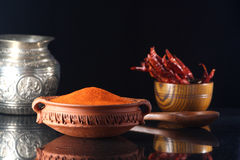 Chilli powder. In a clay dish with dried chillies Stock Photos