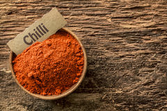 Chilli powder in a rustic wooden bowl Stock Photography