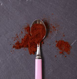 Chilli Powder. On a slate background Royalty Free Stock Photography