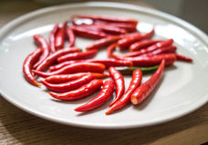 Chilli red on white ceramic plate. Hot chilli red on white ceramic plate Stock Photography