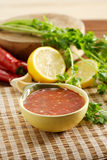 Chilli sauce. Indonesian chilli sauce served with lemon and another ingredient stock images