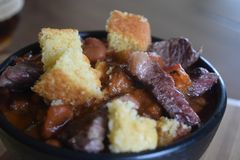 Chilli with short ribs and cornbread croutons royalty free stock image
