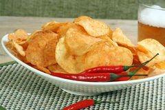 Chilli and sour cream potato chips Stock Images