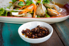 Chilli. Thai chilli paste on wood table Royalty Free Stock Image