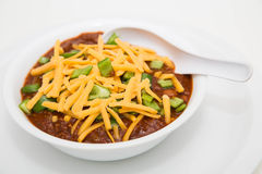 Chilli in White Bowl with Cheese and Poblano Peppers Stock Photography