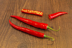 Chillie. Red Chillies shown lying on a wooden background Royalty Free Stock Photography